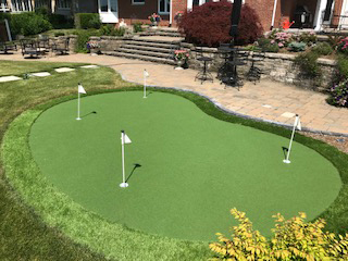 personal putting greens installed in your backyard by lobolandscape london ontario landscping lobo landscape